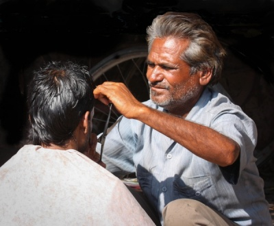 Street Haircut by Colin Wells
