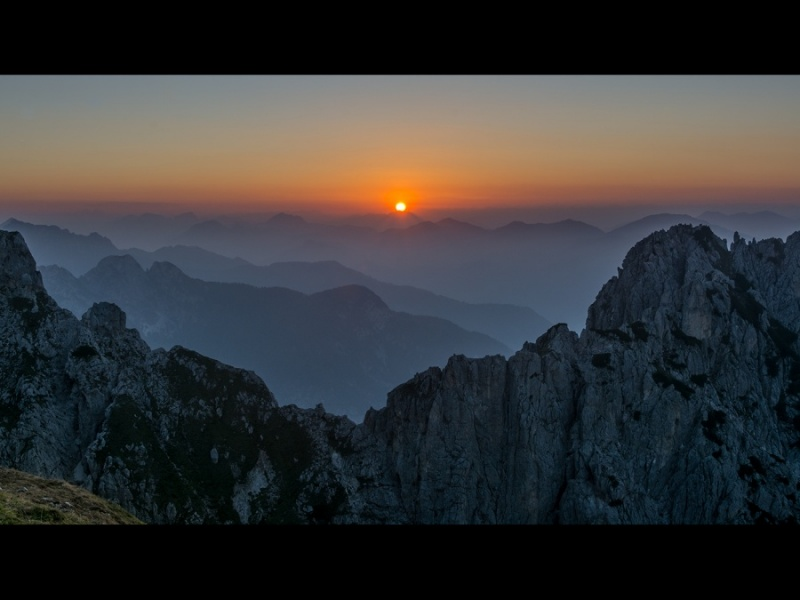 SUNSET OVER ITALY FROM MANGART, SLOVENIA by Dick Bateman